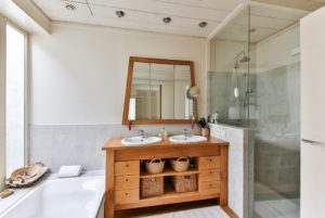 A bathroom with a wood vanity